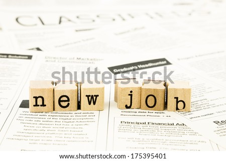 closeup new job wording on classifieds ads and newspaper, recruitment and employment concepts and ideas - stock photo