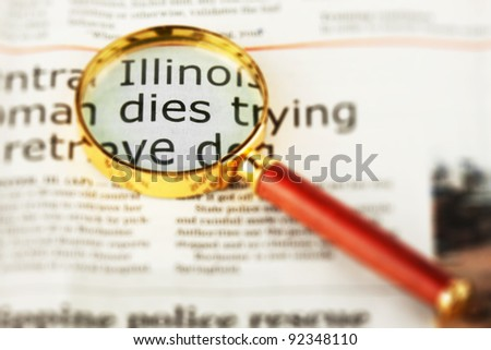 Closeup Newspaper with Magnifying Glass on the white background - stock photo