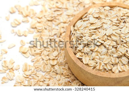 Closeup oats in bowl, on oats background.  - stock photo