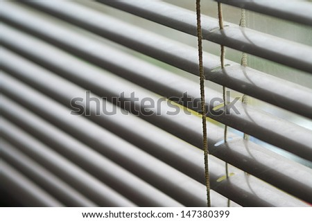 Closeup od silver venetian blinds - stock photo