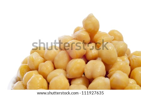closeup of a a pile of boiled chickpeas on a white background - stock photo