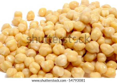 closeup of a a pile of boiled chickpeas on a white background