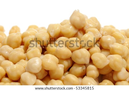 closeup of a a pile of chickpeas on a white bacground
