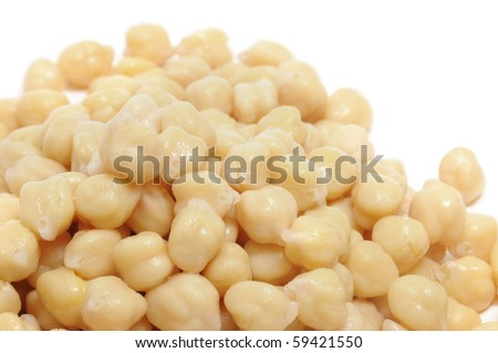 closeup of a a pile of chickpeas on a white background