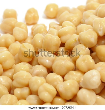 closeup of a a pile of cooked chickpeas on a white background