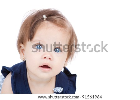 Closeup of a baby girl looking up, isolated on white with room for your text. - stock photo