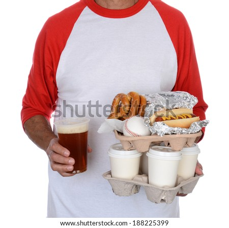Closeup of a baseball fan carrying trays of food and souvenirs back to his seat. The man is unrecognizable and isolated on white. - stock photo