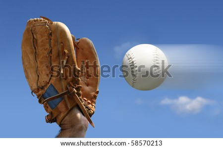 Closeup of a baseball glove catching a baseball.