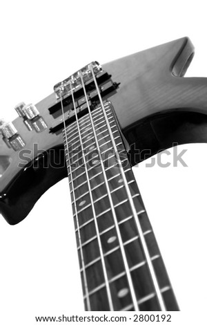 Closeup of a bass guitar - stock photo