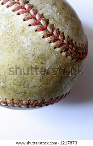 Closeup of a battered old baseball against a white background. - stock photo