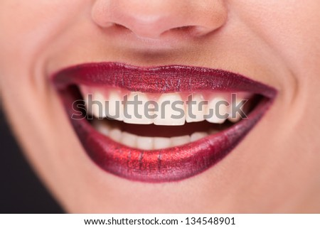 closeup of a beautful pair of smiling red lips