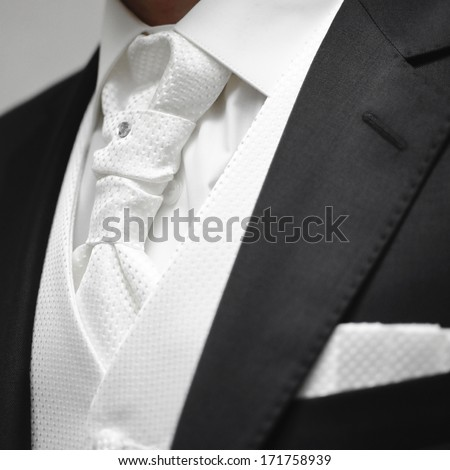 closeup of a beautiful black and white groom's suit - stock photo