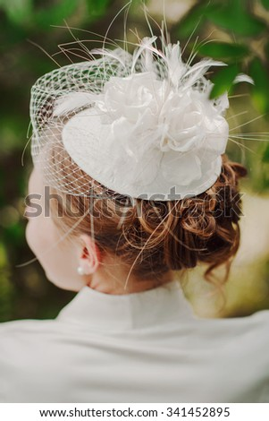 closeup of a beautiful bride's haircut with a white veil - stock photo