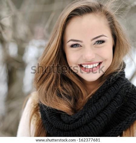 Closeup of a beautiful girl face portrait  - stock photo