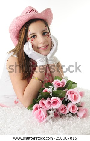 Closeup of a beautiful teen girl in formal gloves and a pink cowgirl hat.  Her face is adorned with sparkly red and pink hearts.  On a white background. - stock photo