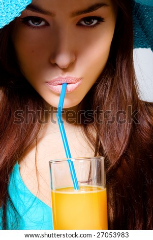 closeup of a beautiful woman drinking orange juice - stock photo