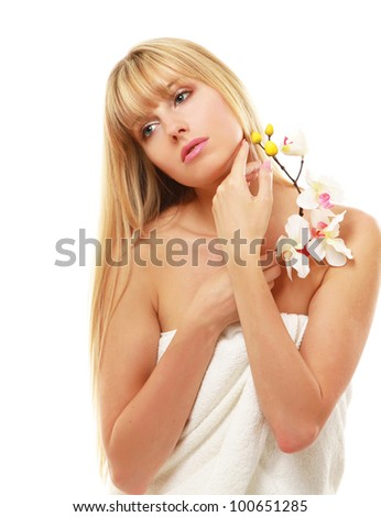Closeup of a beautiful woman holding a flower - stock photo