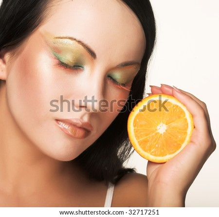 closeup of a beautiful woman`s face with orange