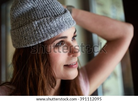 Closeup of a beautiful woman standing in door frame with selective focus