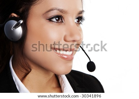 Closeup of a beautiful, young brunette woman with headset - stock photo