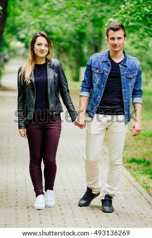 Closeup of a beautiful young couple taking a walk in the park