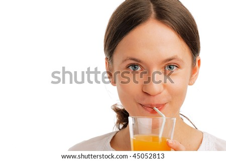 Closeup of a Beautiful young woman sipping juice with a straw on white background - stock photo