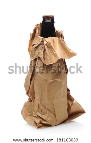 Closeup of a beer bottle inside a brown paper bag. Vertical format, isolated on white with reflection.
