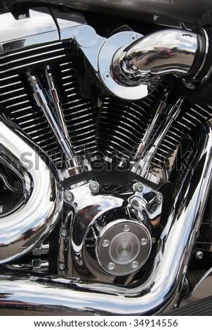 Closeup of a big shiny motorcycle engine - stock photo