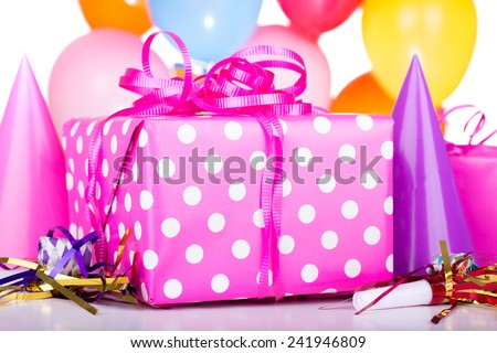 Closeup of a birthday present with decorations - stock photo