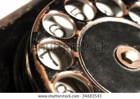 Closeup of a black antique rotary telephone - stock photo