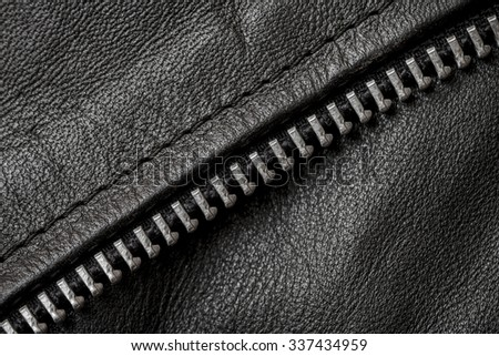 Closeup of  a black leather texture with metal parts - stock photo