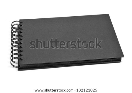 closeup of a blank black notebook on a white background