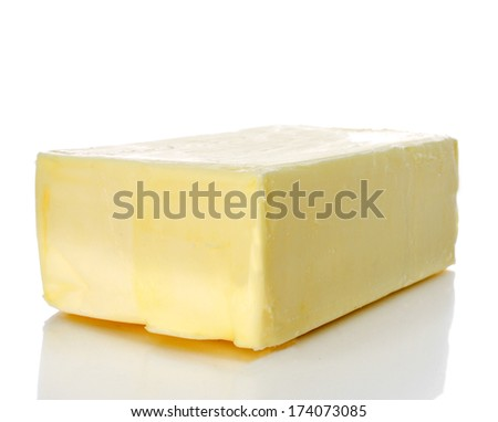 closeup of a block of butter on a white background