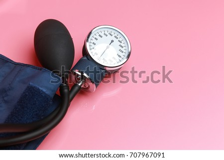 Closeup of a blood pressure on a pink background