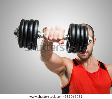 Closeup of a bodybuilder using a dumbbell to work out
