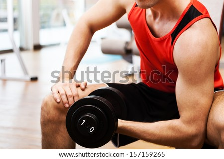 Closeup of a bodybuilder working out