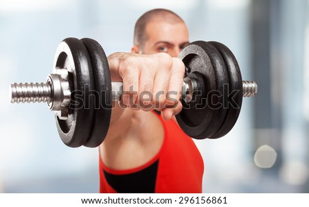 Closeup of a bodybuilder working out - stock photo