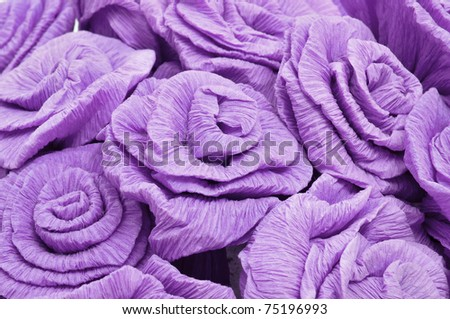 closeup of a bouquet of purple paper roses - stock photo