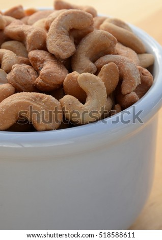 Closeup of a bowl full of whole cashews