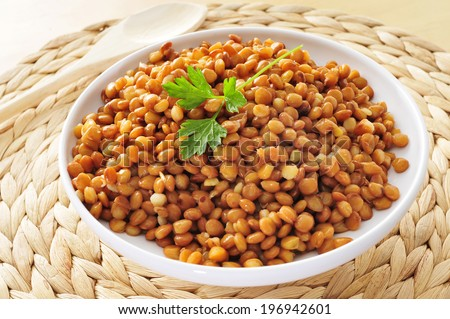 closeup of a bowl with cooked lentils - stock photo