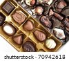 Closeup of a box of assorted chocolate - stock photo