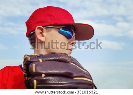 Closeup of a boy pitcher, focus on side of boys face. - stock photo