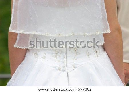 Closeup of a bridal gown. - stock photo