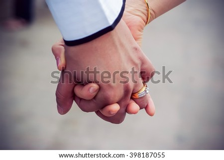 Closeup of a bride and groom holding hands in  wedding day - stock photo