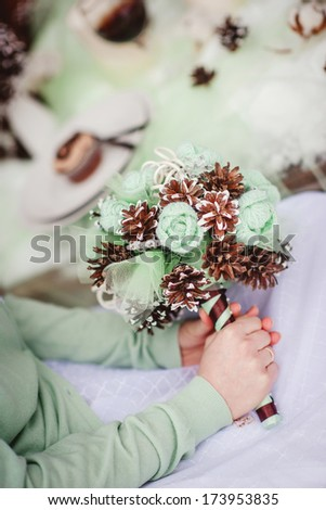 closeup of a bride in white dress holding her wedding bouquet - stock photo
