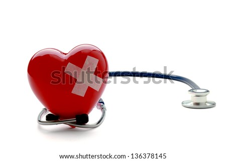 Closeup of a broken heart with a stethoscope, isolated on white - stock photo