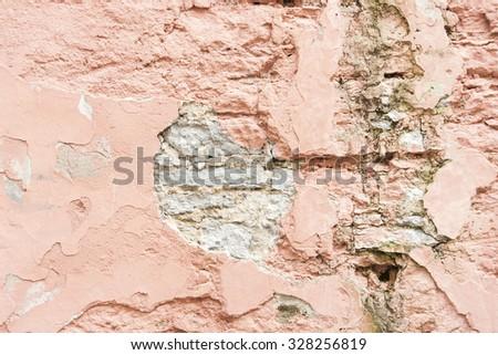 Closeup of a broken limestone wall - stock photo