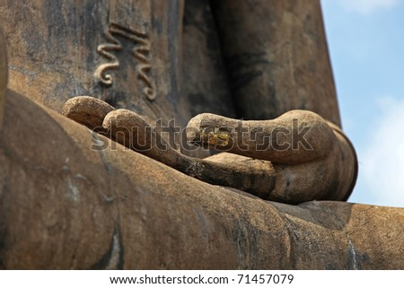Closeup of a Buddha statue's open hand - stock photo