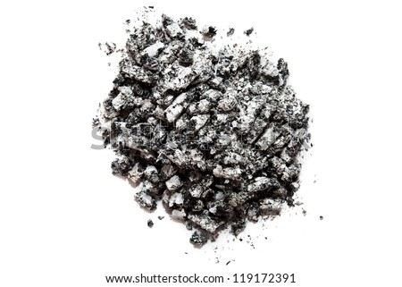 Closeup of a bunch of tobacco ash on white background. - stock photo