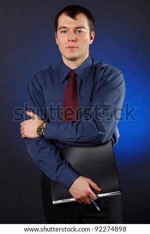 Closeup of a business man holding folder - stock photo
